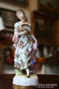 Barokk hölgy legyezővel.