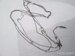 3 soro női nyaklánc különböző lógókkal díszítve