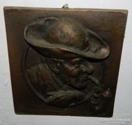 Jelzett bronz falikép