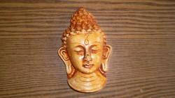 Budha fejek kőből-faliképek