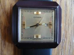 An Nos Citizen wristwatch with a hand-wound
