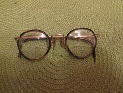 Múlt századi szemüveg, díszes szárral