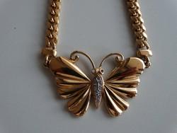 Aranyozott nyaklánc, nyakék pillangó középpel, apró kristályokkal