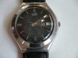 Swatch kvarc szerkezetű svájci óra a fiókból egy elemcsere áráért ... 46990c5fe4