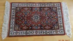 Kézicsomózású gyapjú szőnyeg szép élénk színekkel certifikáttal