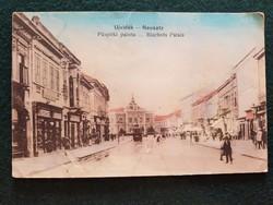 Régi Képeslap, Ujvidék Püspöki Palota, utca részlet, üzletek, villamos