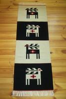 'MEGÚJULÁS' kézzel szőtt iparművész stílusú gyapjú szőnyeg, faliszőnyeg, szarvas motívummal