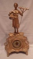 Kandalló óra szoborral