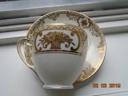 NORITAKE luxus japán porcelán aranybrokát virágkosár mintával ,újszerű csokoládés csésze alátéttel