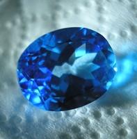 Ovális fezttált intenzív kék topáz drágakő,  (62)