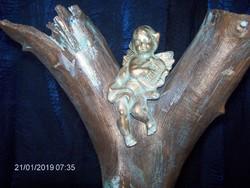 Angyali dallamok c. fából, kőből egyebekből készült bronzírozott szoborapplikáció. Károlyfi Zsófia