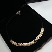 Desinger aranyozott ezüst,onix kővel