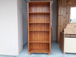 Eladó egy pácolt fenyő könyves szekrény Bútor  jó állapotú.