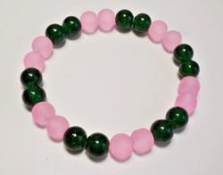 Roppantott és matt üveg gyöngyös karkötő sötétzöld és rózsaszín