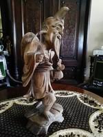 Keleti faragott fa szobor