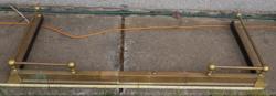 130-140 centi szélességben változtatható, rézlap borítású, és réz oszlopos kályhaelő