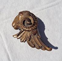Bronz kidolgozott kosfej