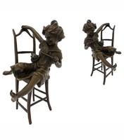 Cicával játszadozó kislány bronz szobrok