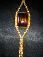 Arany szinű, bizsu nyaklánc, szögletes barna színű,üveggel diszitve!