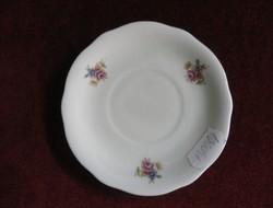 Zsolnay porcelán kávés csésze alátét. Krém színű, apró virágmintával. Antik. Átmérője 10,5 cm.
