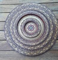 Festett ,faragott fa 4 db egymásba rakható fali tányér ,fali dísz,