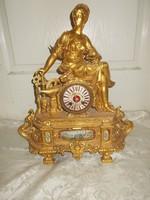 Antik díszes nőalakos felesütős kandalló óra