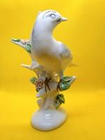 Nagyon szép porcelán madár virágzó faágon