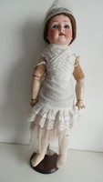 Porcelánfejű baba