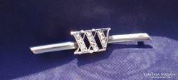 XXV. ezüst-arany-gyémánt kitüző