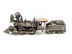 Ezüst vonat forgó kerekekkel Gyártó UnoAerre Jelzett ezüst