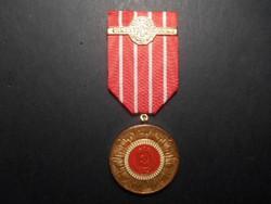 Román kitüntetés