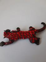 Piros Kristaly Tigris Bross Kituzo