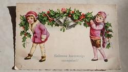 Régi karácsonyi képeslap csengős magyalfüzéres gyerekek
