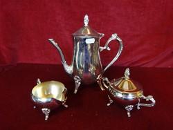 Négy lábon álló fém  teáskanna, cukortartó, tejkiöntő.