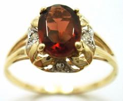 Tömör arany gyűrű gyémánt és gránát kövekkel