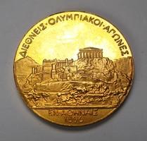 Az 1896-os athéni olimpiai aranyérem kisebb másolata.