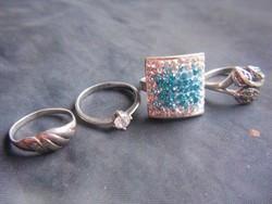 4 db 925-ös ezüst gyűrű. Három köves, egy sima. Kiváló ajándék hölgyeknek.