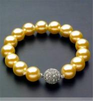 Shell gyöngy karkötő, arany színű 10 mm-s gyöngyökből