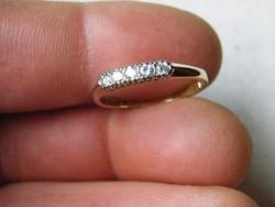 KK535  9 karátos sárga arany gyűrű brill kövekkel 1/4 karát gyémánt