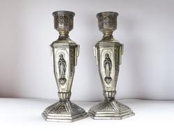 Régi,ezüstözött ón vallási díszítésű gyertyatartó pár.