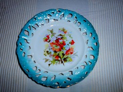 Antique wall plate with openwork border