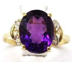 Tömör 10k arany gyémánt gyűrű viola-lila kővel