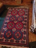 Kézicsomózású gyapjú szőnyeg