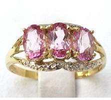 Tömör 375-ös arany gyémánt gyűrű pink topáz kővel