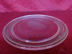 Mikrohullámú sütő üvegtányérja, melynek átmérője 24,5  cm.