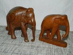Faragott fa elefántok együtt.