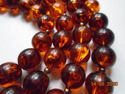 Konyak borostyán színű gyöngyökből nyaklánc 120 cm