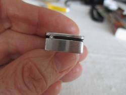 Gyémánt (valódi, brill csiszolás, 0,02 kt) acélba foglalva: design gyűrű, Ribeiro terve