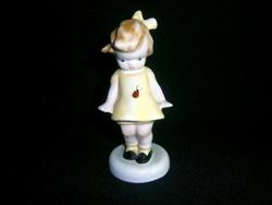 Bodrogkeresztúri kerámia katicás kislány sárga ruhában, világos barna hajjal
