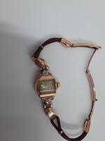 Vintage14 karátos tokban, két pici gyémánttal, Swiss szerkezetű mechanikus női karóra